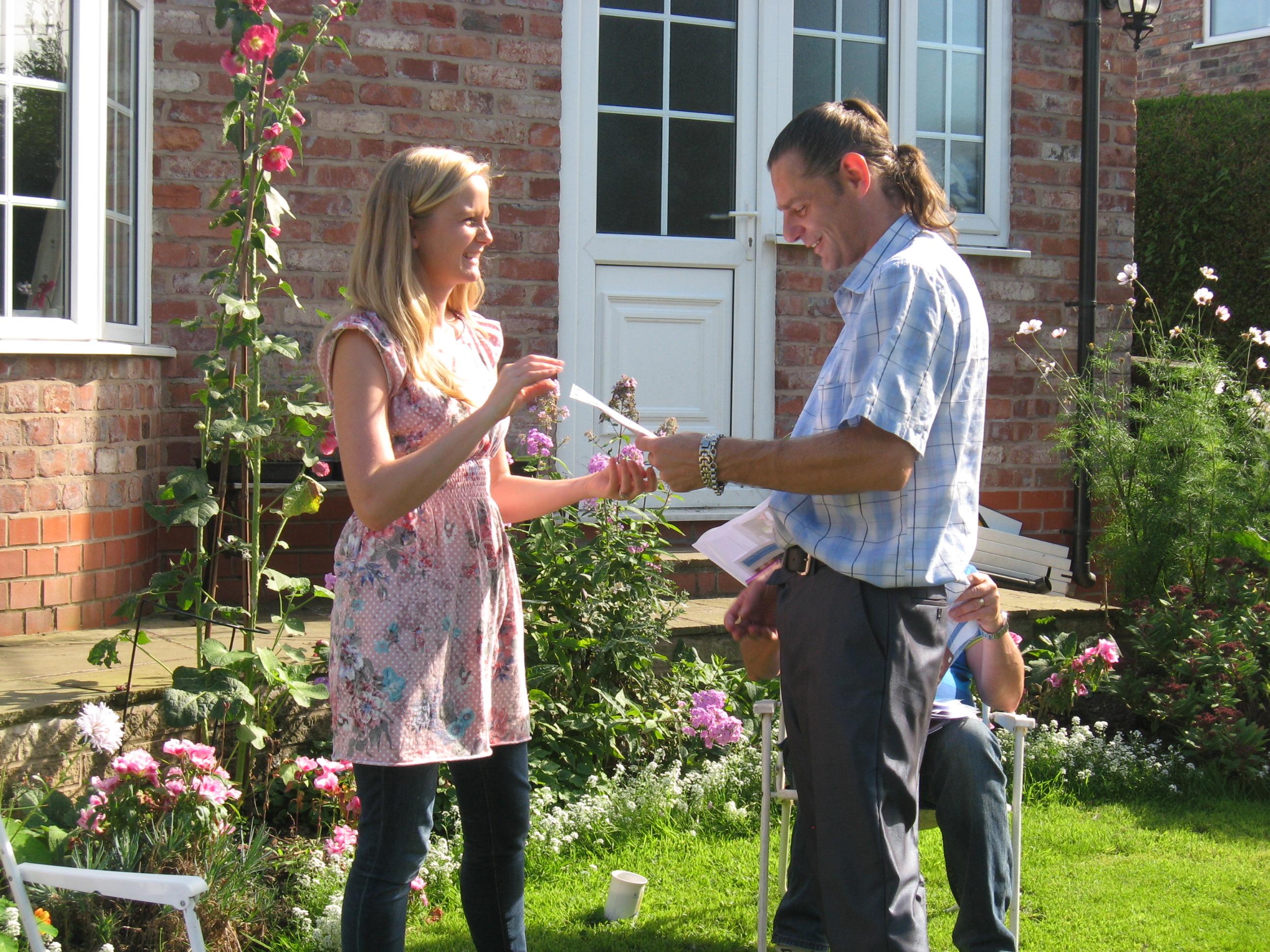 Neil receiving his certificate from Lauren