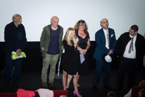 Taking a bow at the premiere